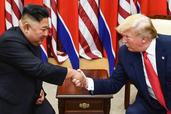 Kim Jung Un and Donald Trump shaking hands