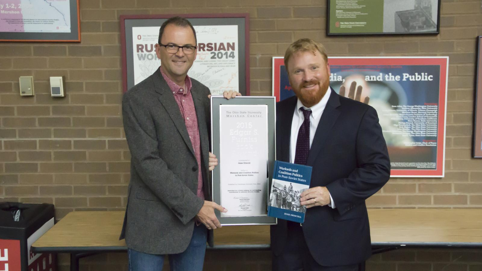 "Mershon Center Director Christopher Gelpi presents the Furniss Book Award to Jesse Driscoll, author of ""Warlords and Coalition Politics in Post-Soviet States."""